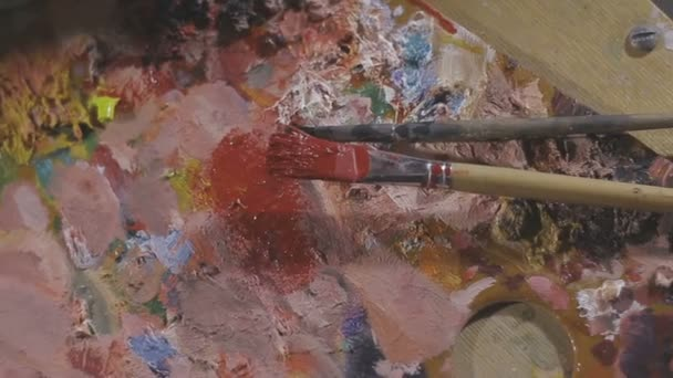 Paints and brushes on the easel