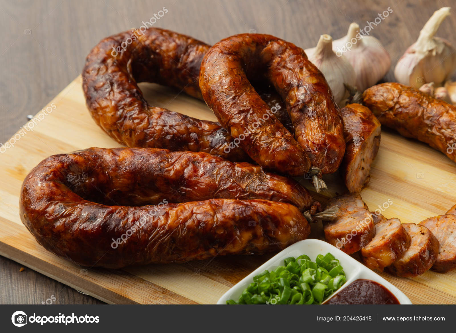 Homemade sausage on a wooden background