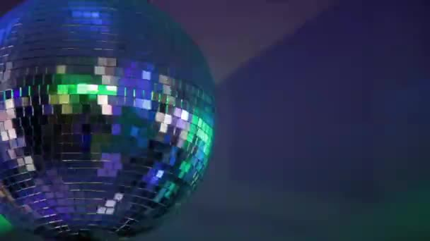 Mirror club ball with light reflections and camera movement.