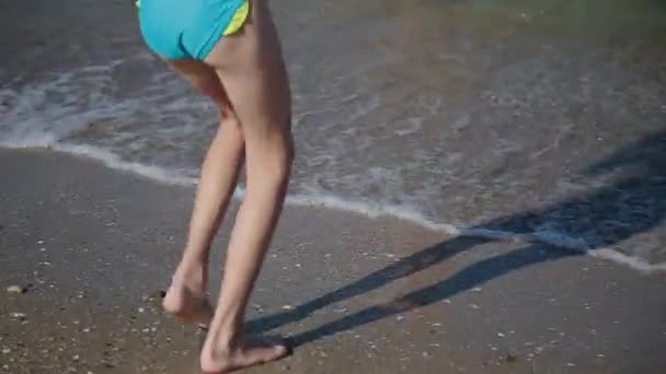 Legs in sea water, with an influx of waves.