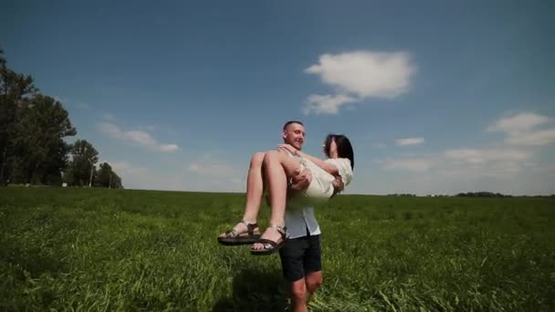 Loving couple having fun on the field on a sunny day.