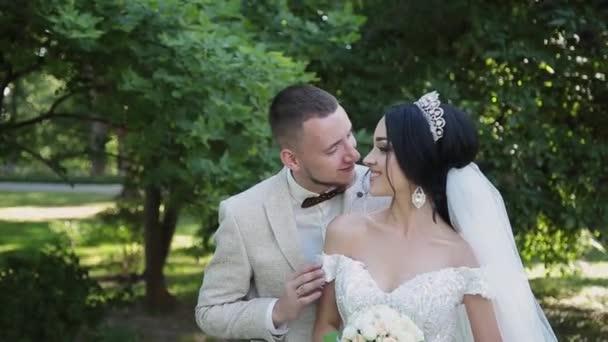 Newlyweds hug and enjoy each other on their wedding day.