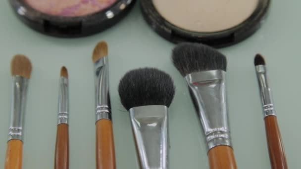 Set of brushes for make-up on table in dressing room. Fashion industry. Fashion show backstage