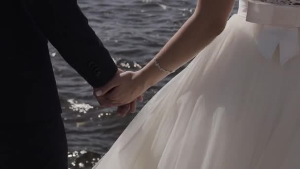 Marry Me Today And Everyday. Newlywed Couple Holding Hands, Shot In Slow Motion.