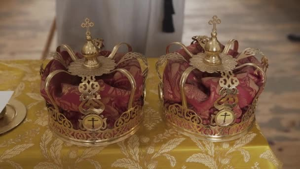 Church attributes for wedding ceremony. Gold crowns are on the altar.