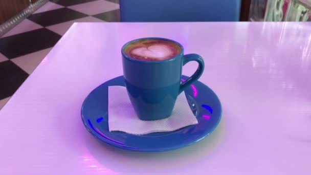 Hot cappuccino on the table.