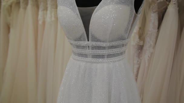 Beautiful wedding dresses in a bridal salon.