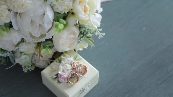 Wedding delicate bouquet with rings on a box.