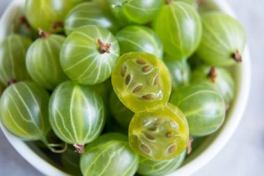 macro shot of a cut gooseberry fresh berries. Copy space. Vitamins. Summer berries. Close up, top view, high resolution product Harvest Concept