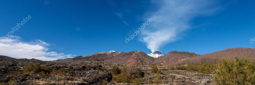 The mount Etna Volcano with smoke in winter. Catania, Sicily island, Italy, Europe