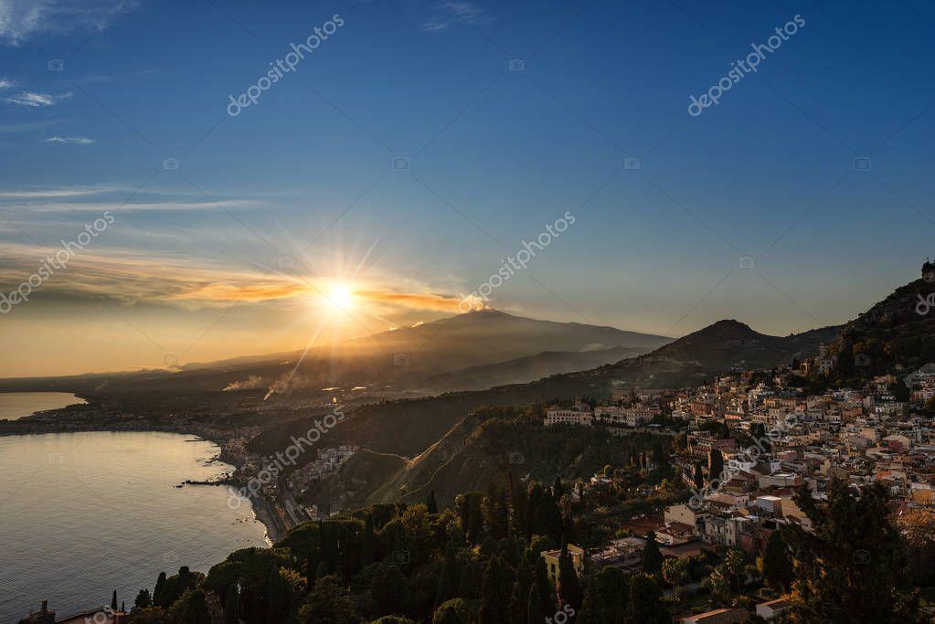 Mount Etna Volcano with smoke and the Taormina town, Messina, Sicily island, Italy, Europe