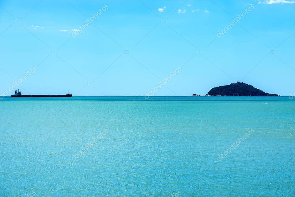 Empty Container Ship and the Tino island - Liguria Italy