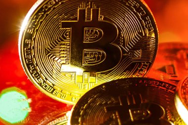 Bitcoins gold on red background, lights