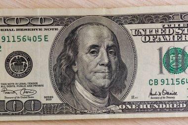 Portrait of benjamin franklin on the hundred dollar bill closeup