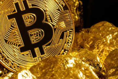 Golden bitcoin coin and mound of gold bitcoin cryptocurrency business