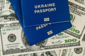 Fotografie biometric passports and banknotes of  hundred dollars visa free travel concept