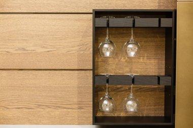 Fancy drinking glasses stored in a cupboard