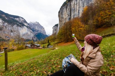 Young girl in lauterbrunnen in Switzerland with panoramic view of Swiss alps