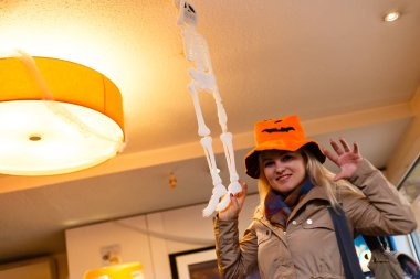 Halloween Party girl wearing coat and funny hat