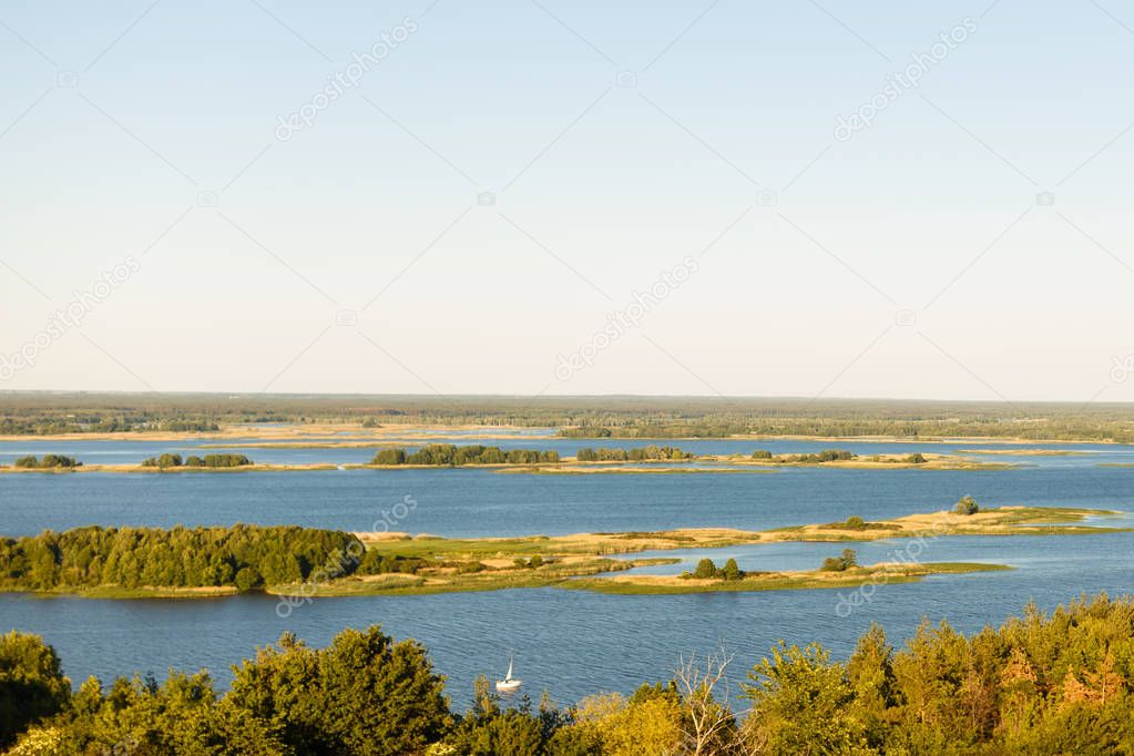 Picturesque panoramic view from the height on the touristic part of the Volga river near Samara city at summer sunny day.