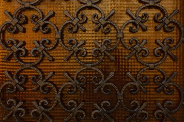 Old iron gate with grunge and rusty steel background