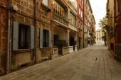Photo view of a small narrow street, italian city venice