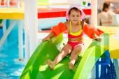 aqua park, Girl slide down on water slide