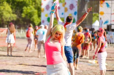 Painted girl dances at the Holi Festival