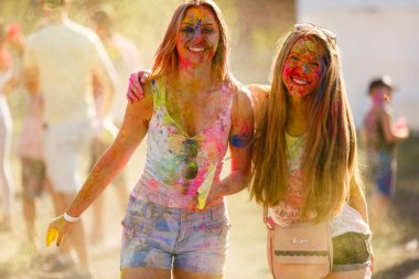 Kiev, UKRAINE - August 13, 2017: Celebrants at the color Holi Festival stock vector