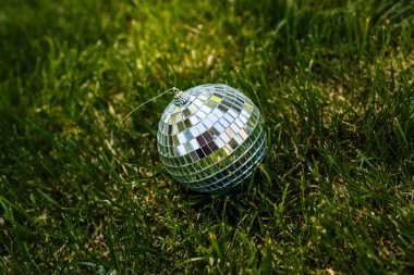 Decorative disco ball lying in the grass