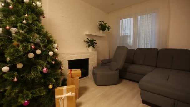 Stylish interior with fireplace and decorated Christmas tree with gifts