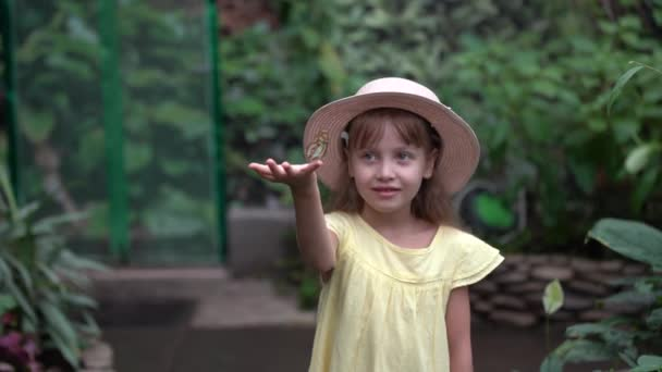 Seven year old child with butterfly on finger