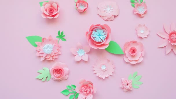 Stop motion animation, the heart of the paper flowers shatters into small flowers and then going back