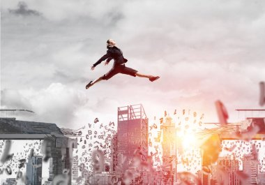 Business woman jumping over gap with flying letters in concrete bridge as symbol of overcoming challenges. Cityscape and sunlight on background. 3D rendering.