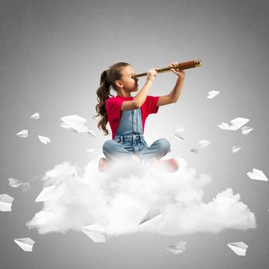 Cute kid girl sitting on cloud looking in spyglass and paper planes flying around