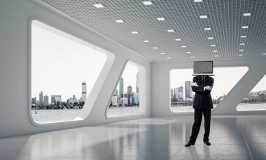 Businessman in suit with laptop instead of head keeping arms crossed while standing inside office building. 3D rendering.
