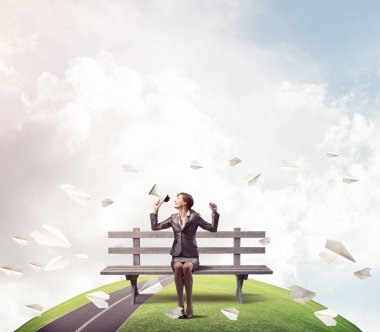 Business woman with megaphone on wooden bench. Female speaker shouting in loudspeaker outdoors. Panorama with round horizon of world and flying paper planes. Business marketing and announcement. stock vector