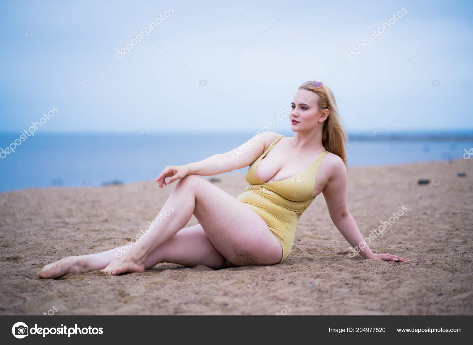 cb470201dff Beautiful plus size model wearing fashion swimsuit and sunglasses– stock  image