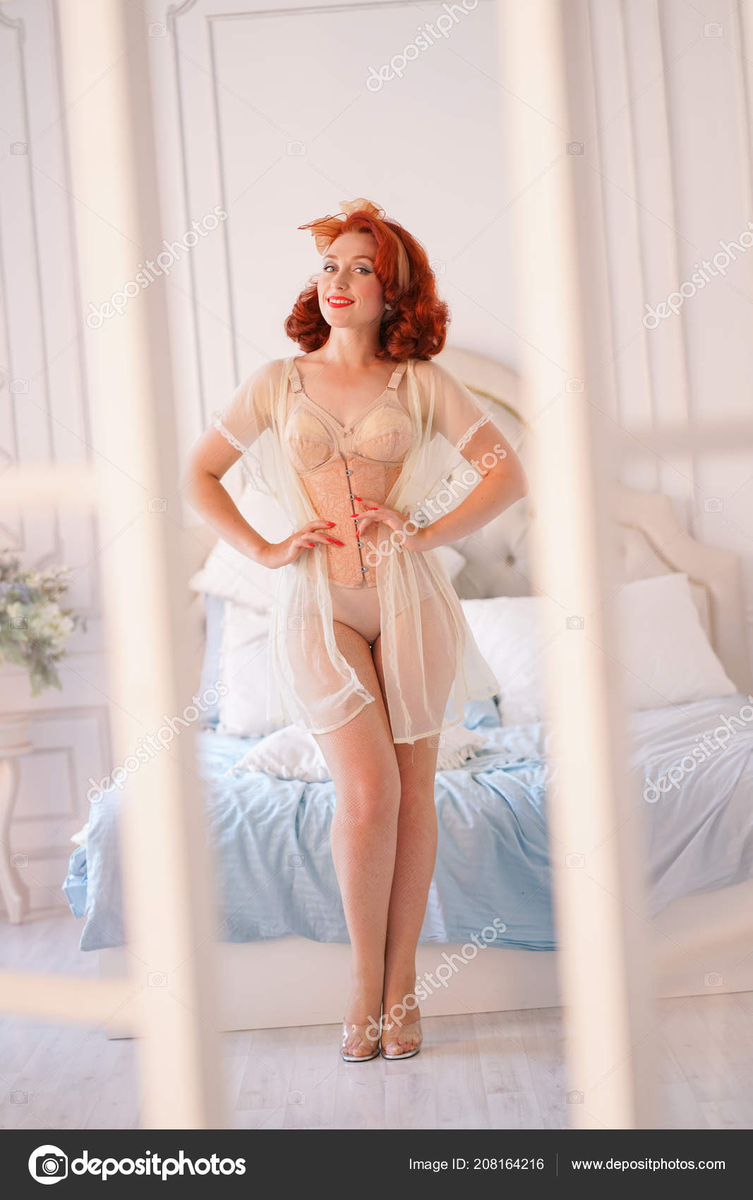 7ab5c7e69 Charming vintage girl posing in beige pin-up lingerie and tight corset with sheer  nightgown on top — Photo by ...