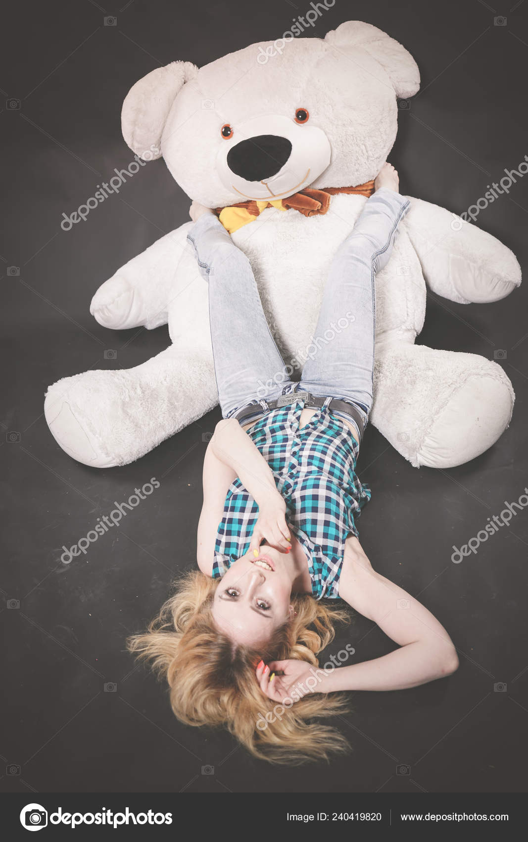 Blonde teen with toys