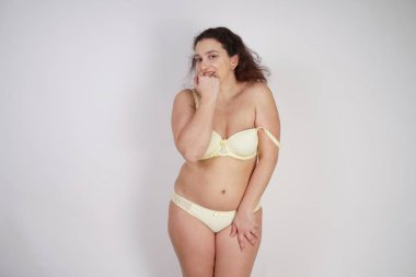 cute chubby woman wearing sexy lingerie on white background