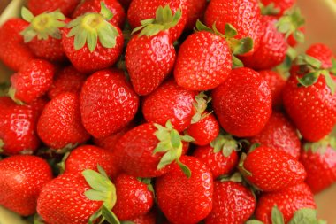 background from freshly harvested red strawberries