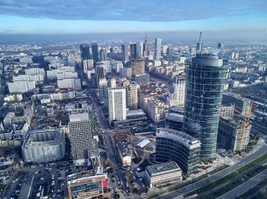 WARSAW, POLAND - NOVEMBER 27, 2018: Beautiful panoramic aerial drone view to the center of Warsaw City and The Warsaw Spire - 220 metre neomodern office building on European square (Plac Europejski)
