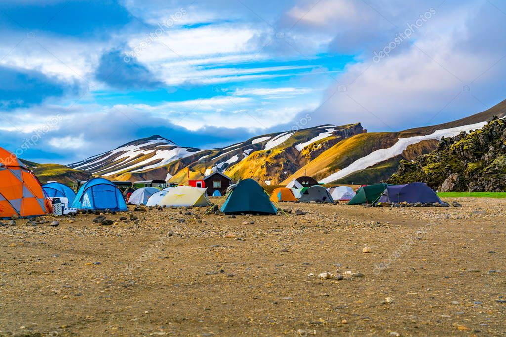View of tents and camping at Landmannalaugar camping site in Highlands of Iceland in summer