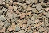Textura pozadí mnoha malých šedých kamenů