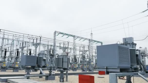 Closeup transforming substation consists of electrical energy converters transformers and control devices under cloudy sky