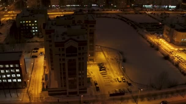 night city modern buildings covered with snow aerial