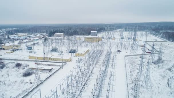 white territory of electricity transmission substation with towers