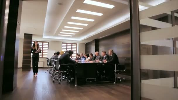 company management negotiates at meeting in modern office