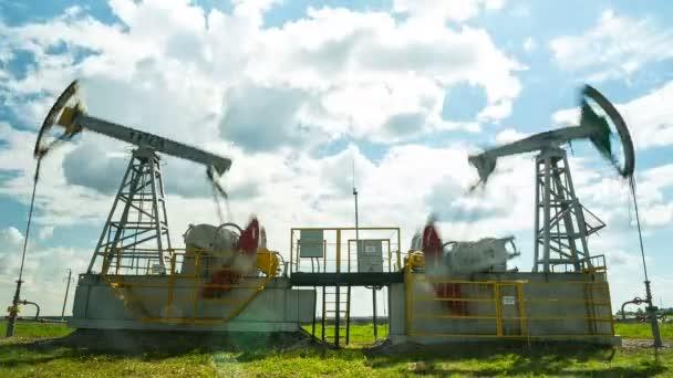 powerful pump jacks extract crude oil on field